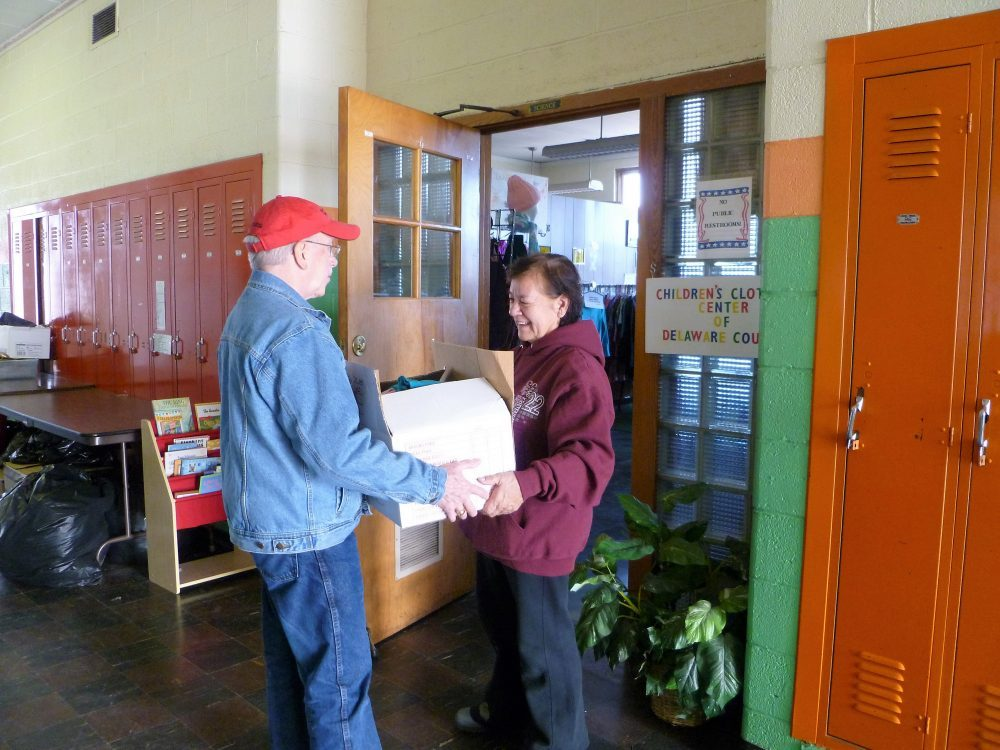 Volunteer Delivering Clothing Donations